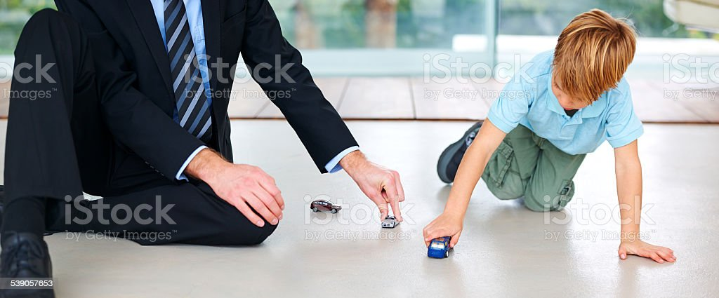 So glad Dad's home A little boy playing with his father on the floorhttp://195.154.178.81/DATA/i_collage/pi/shoots/785121.jpg 2015 Stock Photo