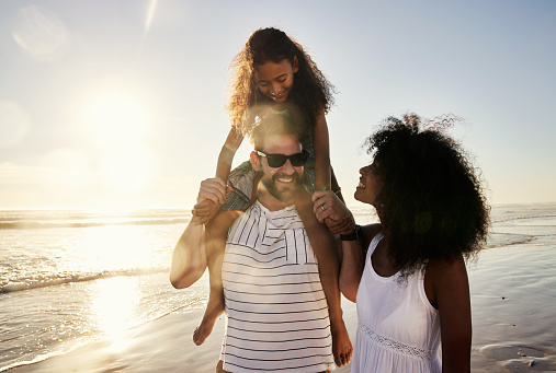 Shot of a happy family spending time at the beach