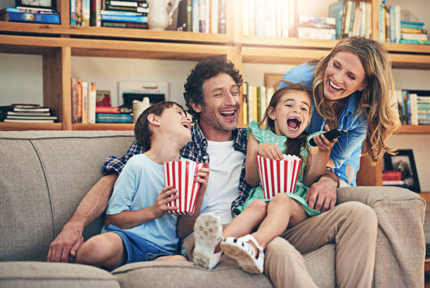 so many fun memories were made on family movie night - family watching tv stock photos and pictures