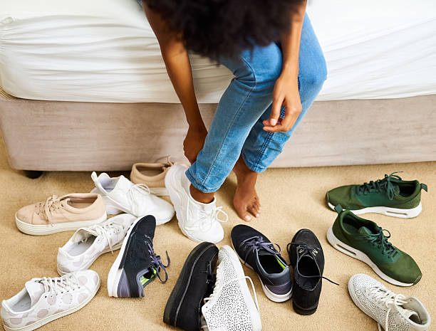 so many shoes, only two feet - shoe stock photos and pictures