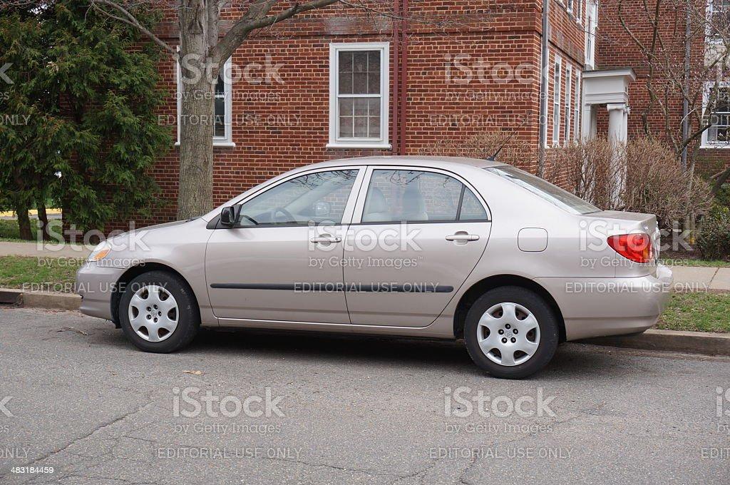 Tan Toyota Corolla stock photo