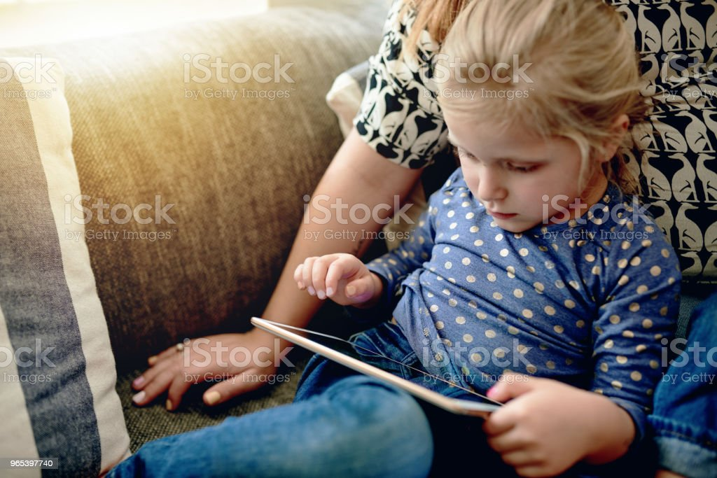 So young and already so tech savvy royalty-free stock photo