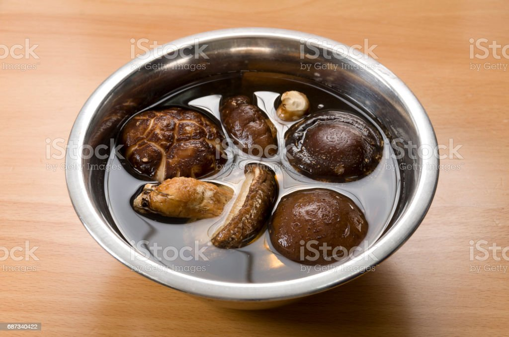 soak dried Shiitake mushrooms in water stock photo