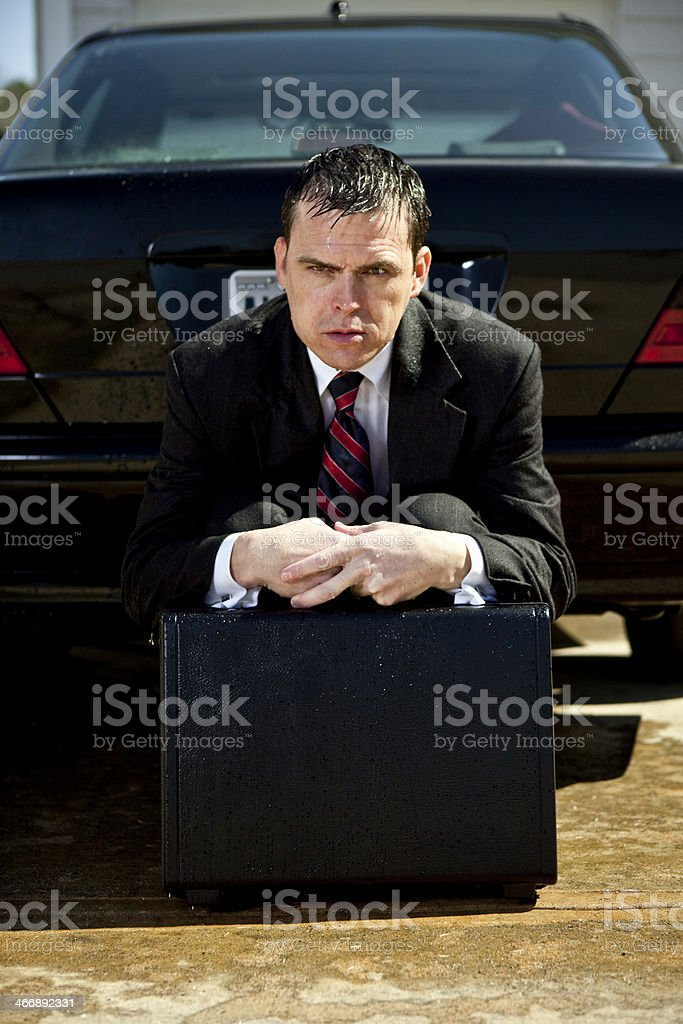 soaked and wet with briefcase in hand royalty-free stock photo