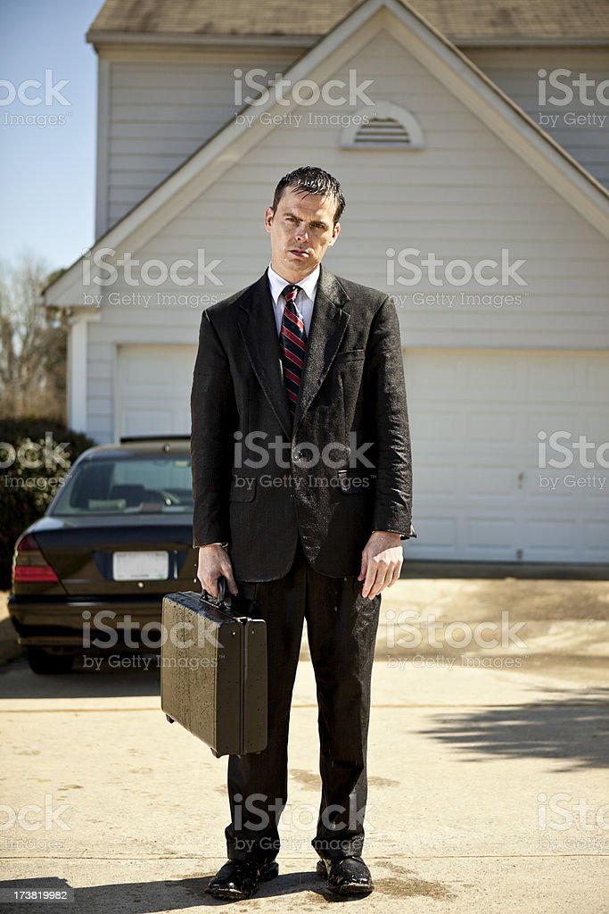 soaked businessman stock photo