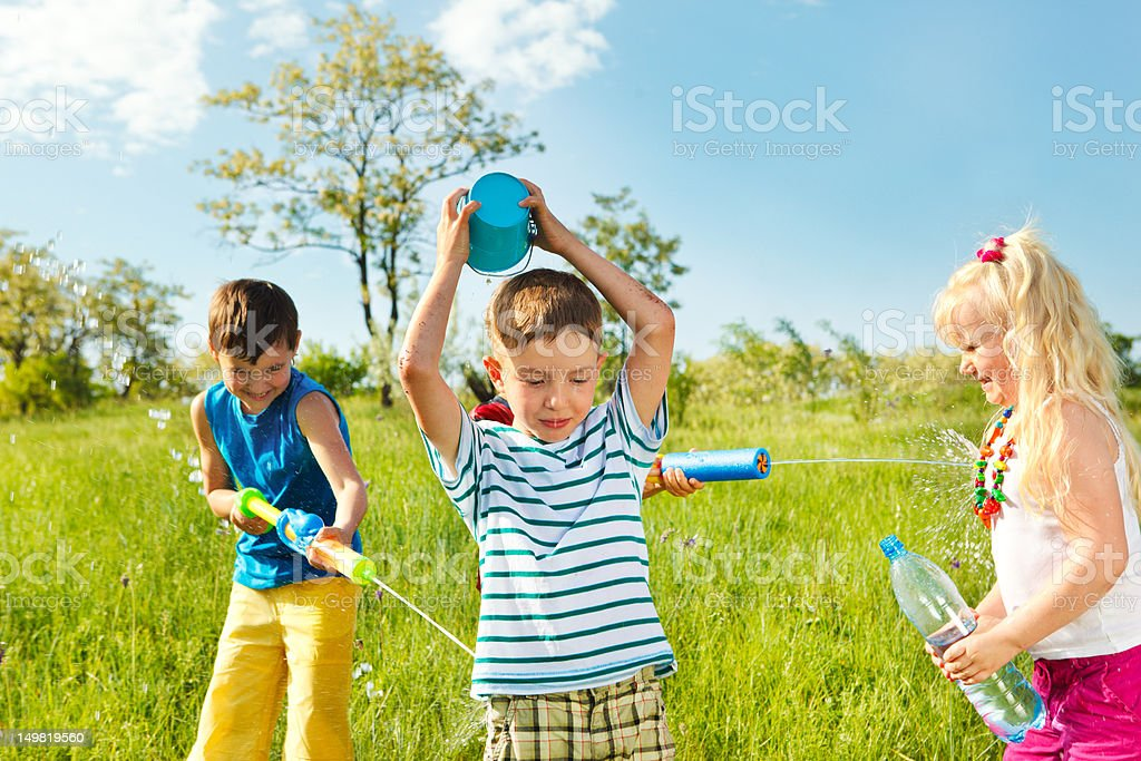 Soaked happy kids stock photo