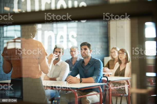 Shot of a group of businesspeople sitting in the boardroom during a presentation