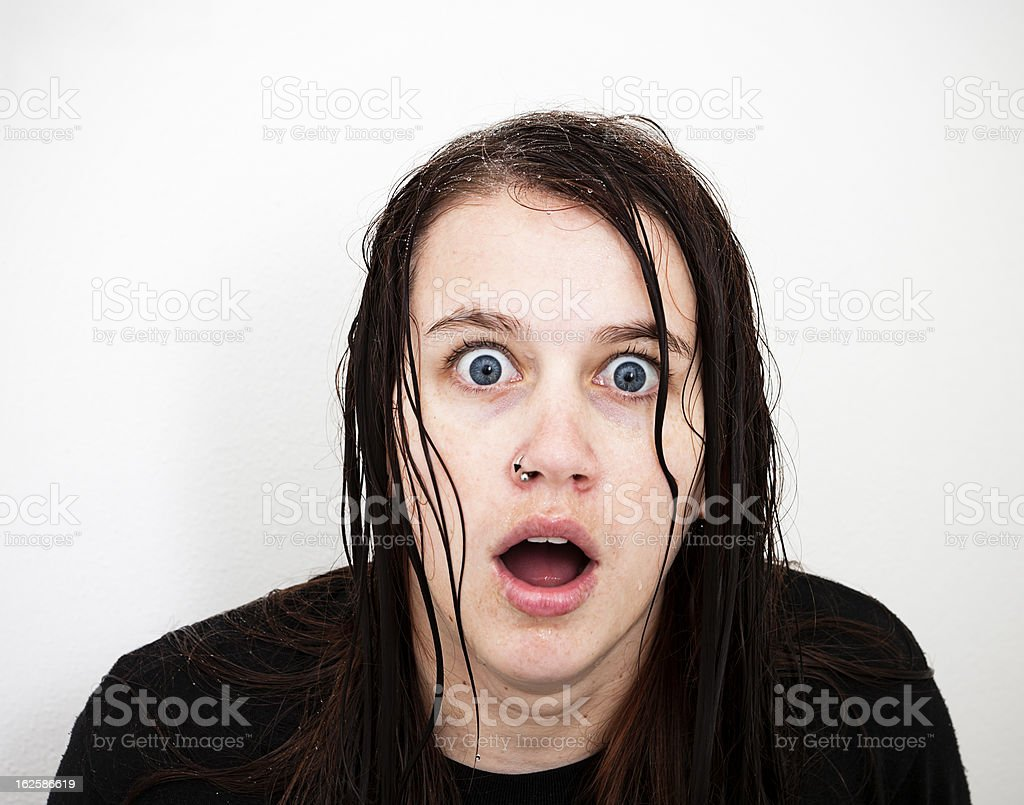 Soaking wet, horrified young woman gasps in shock stock photo