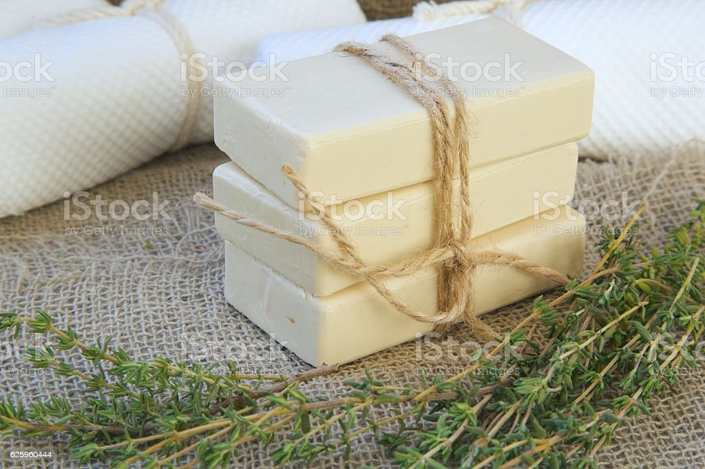 Soap bars with thyme essential oil stock photo