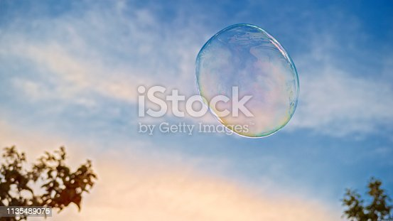 Soap bubble against sky during sunset.