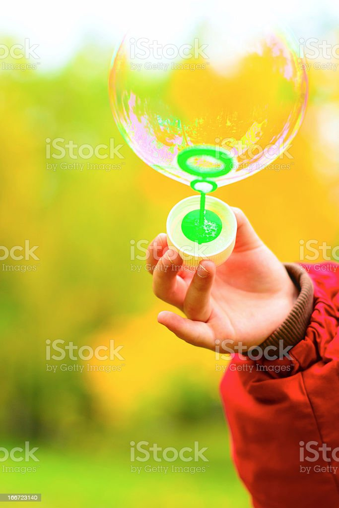 Soap bubble in the child's hand royalty-free stock photo