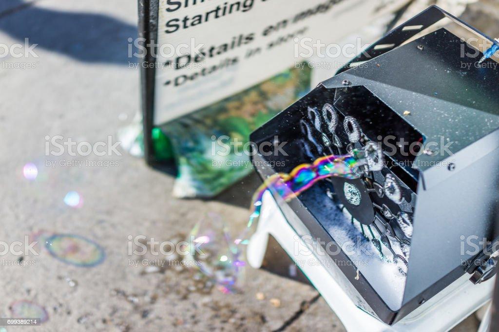 Soap bubble machine with colorful bubbles macro closeup stock photo