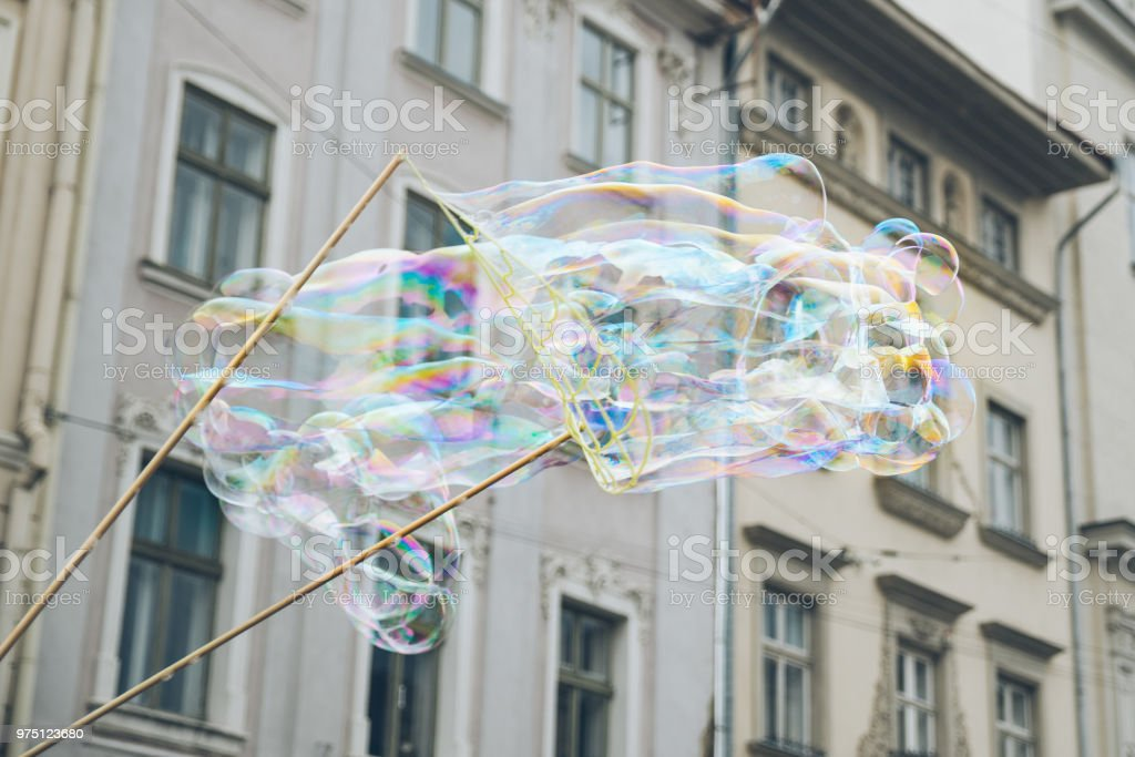 soap bubbles in the center of old european city. having fun stock photo