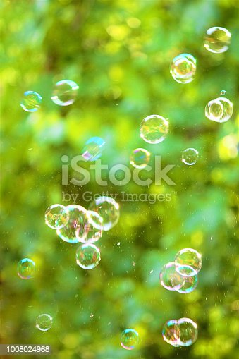Soap bubbles on an abstract background. Pay attention to the blurred image.
