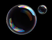 istock Soap Bubbles on black background 1253992268