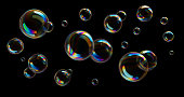 istock Soap Bubbles on black background 1253992321