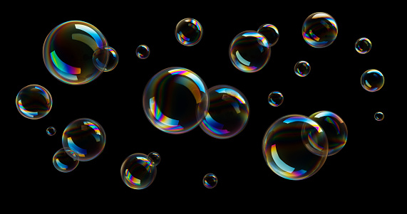 Group of colorful soap bubbles flying on black background