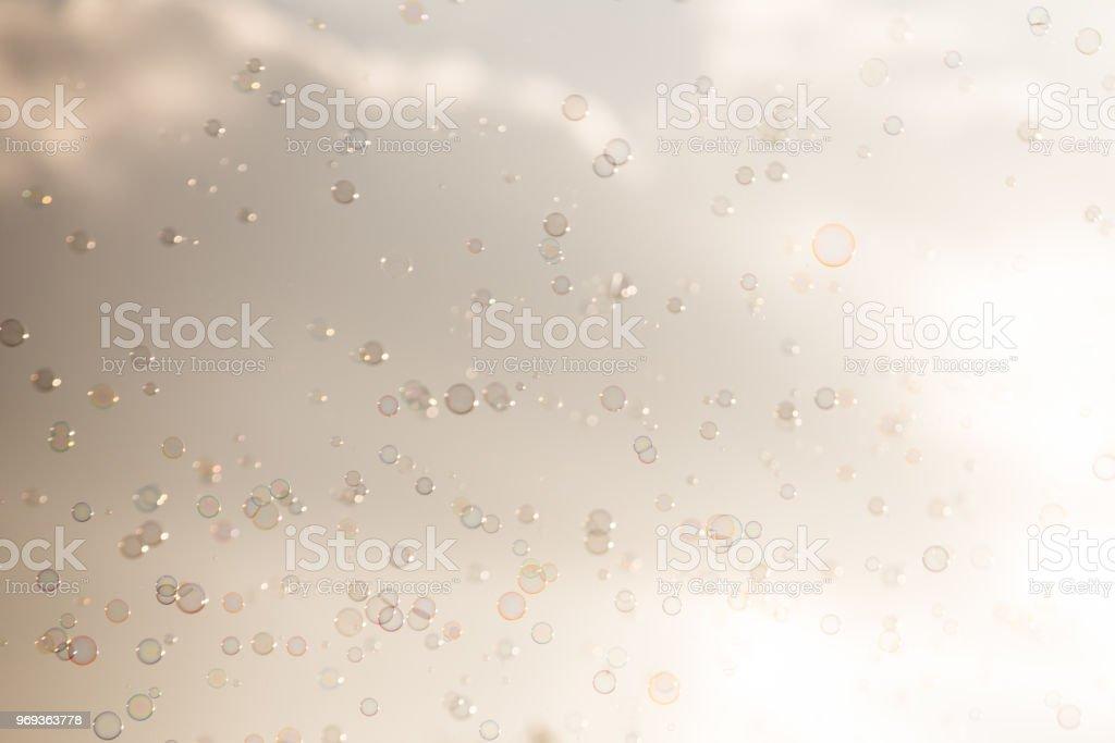 Soap bubbles on sky stock photo