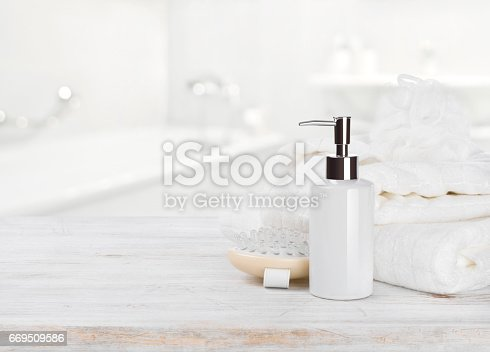 istock Soap dispencer, towels, massager and wisp of bast over blur 669509586