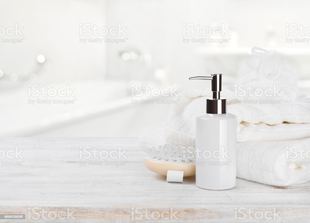 Soap dispencer, towels, massager and wisp of bast over blur stock photo