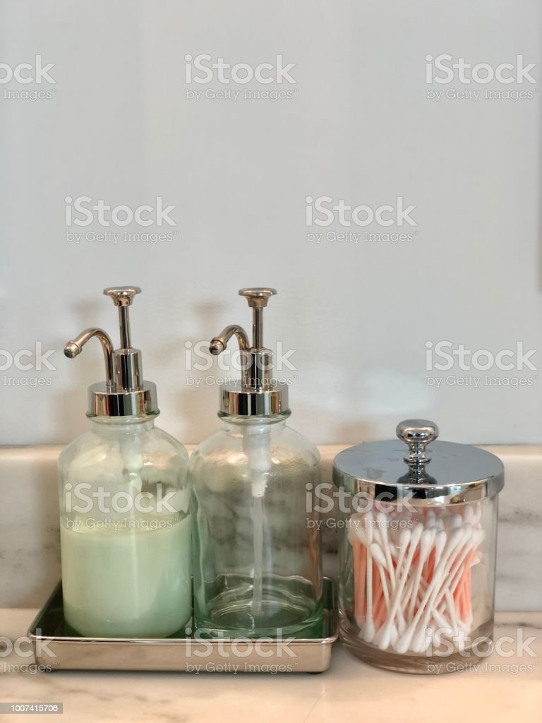 Soap dispenser and q tips stock photo