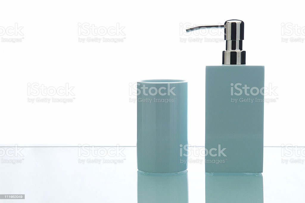 Soap Dispenser and Toothbrush Cup Isolated on White Background royalty-free stock photo