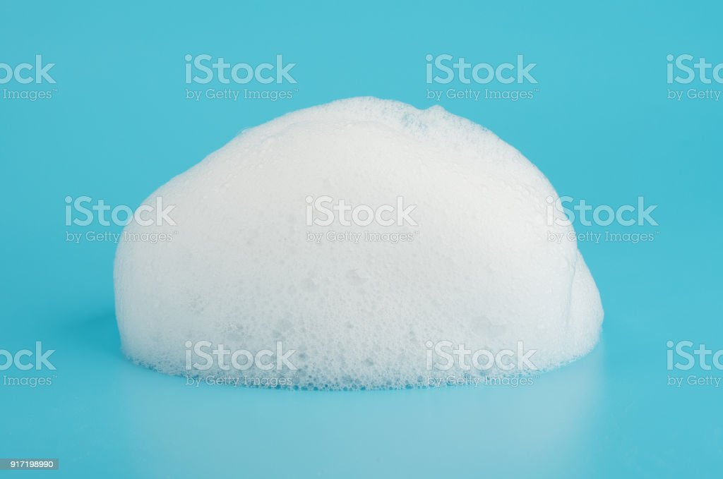 Soap foam bubble isolated on blue background object beatuy health care concept stock photo