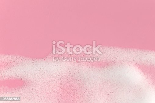 istock Soap foam bubbles on pink background macro close up. Free copy space. 933582886