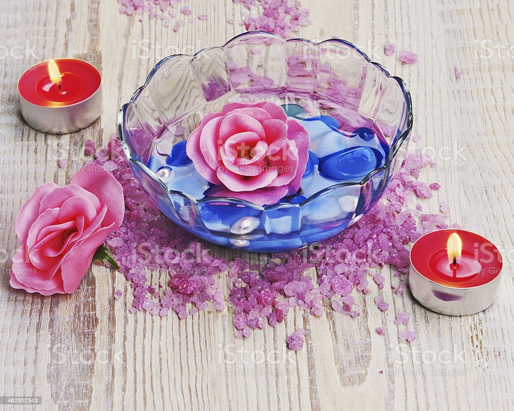 Soap in form of roses in bowl of water royalty-free stock photo