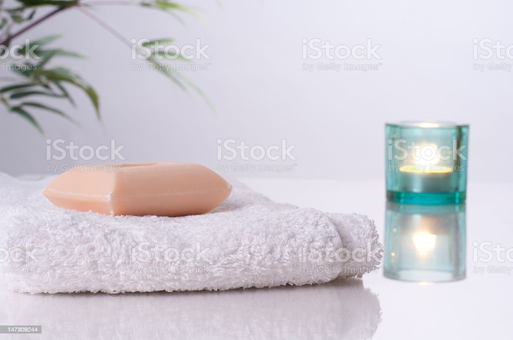 Soap on a towel with light background stock photo