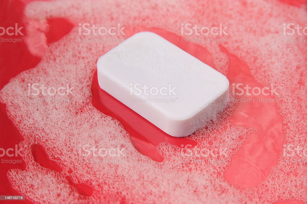 soap on red background stock photo