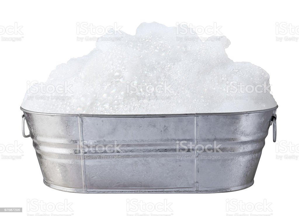 Soap Suds and Bubbles in a tub stock photo
