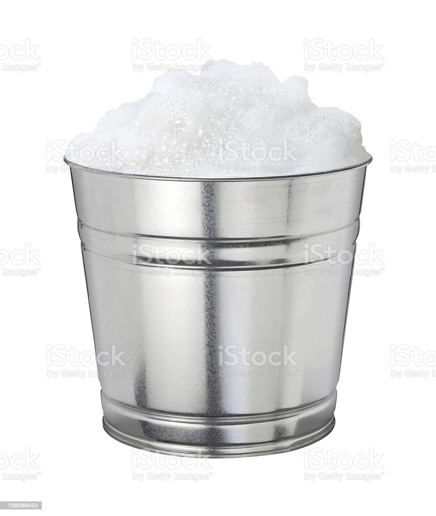 Soapsuds in a Shiny Metal Bucket royalty-free stock photo