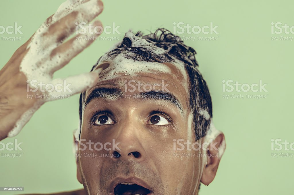 Soapy male mestizo, or mixed-looking in hand and shocked because - foto de acervo