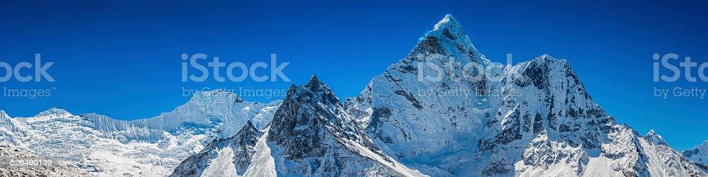 Soaring summits snowy peaks pinnacles panorama Himalaya mountain wilderness Nepal stock photo