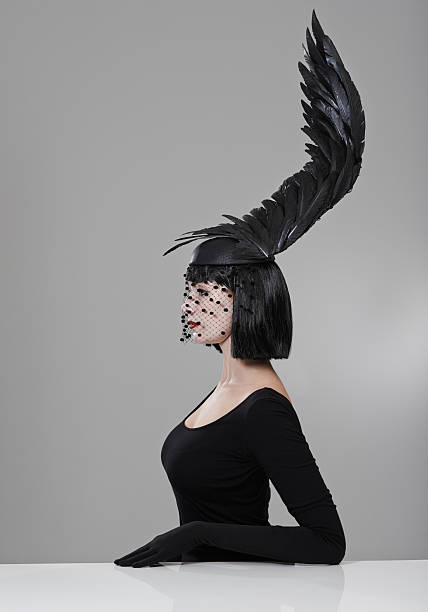 soaring to new heights in fashion - gothic fashion stock photos and pictures