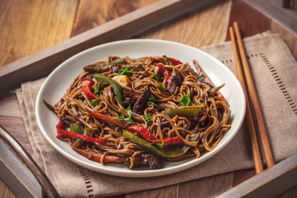Soba noodles with vegetables and beef, asian style cuisine. stock photo