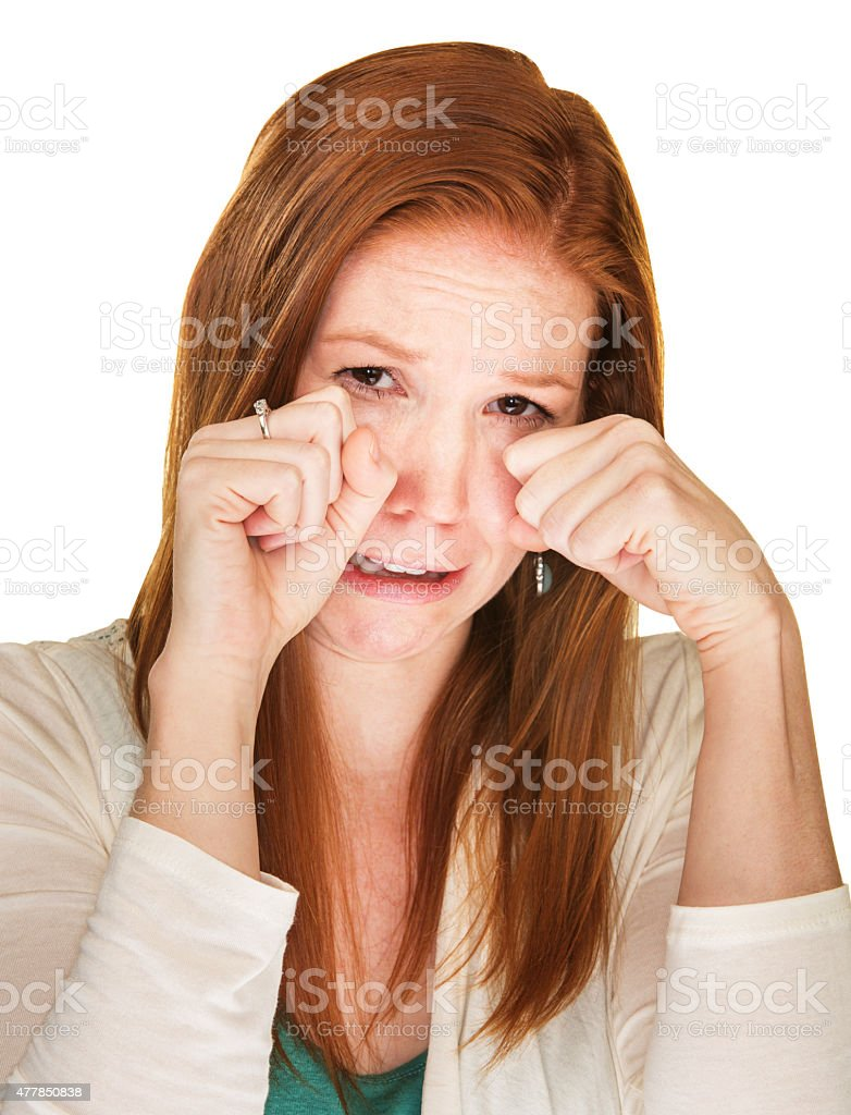 Sobbing Woman Rubbing Her Eyes stock photo