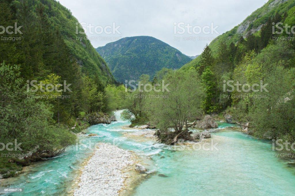 Soca river flowing between green hills royalty-free stock photo