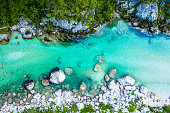 Soca River in Slovenia. Beautiful Aerial of turquoise Mountain River.
