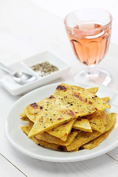 socca, farinata, chickpea pancake socca, farinata, chickpea pancake with rose wine farinata stock pictures, royalty-free photos & images