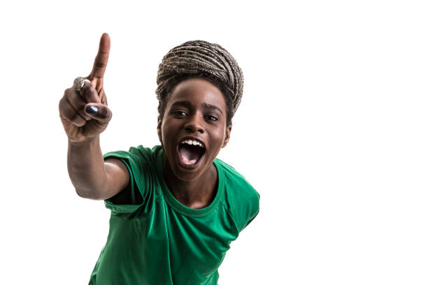 Soccer afro young woman celebrating on green uniform isolated on white background stock photo