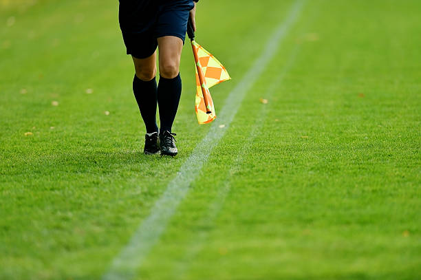 Soccer assistant referee Assistant referee running along the sideline during a soccer match referee stock pictures, royalty-free photos & images