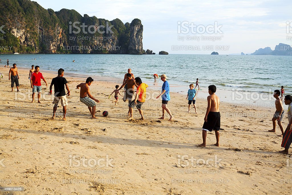 Soccer at beach in sunset royalty-free stock photo