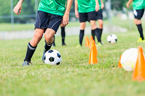 Soccer athlete participates in soccer practice drills