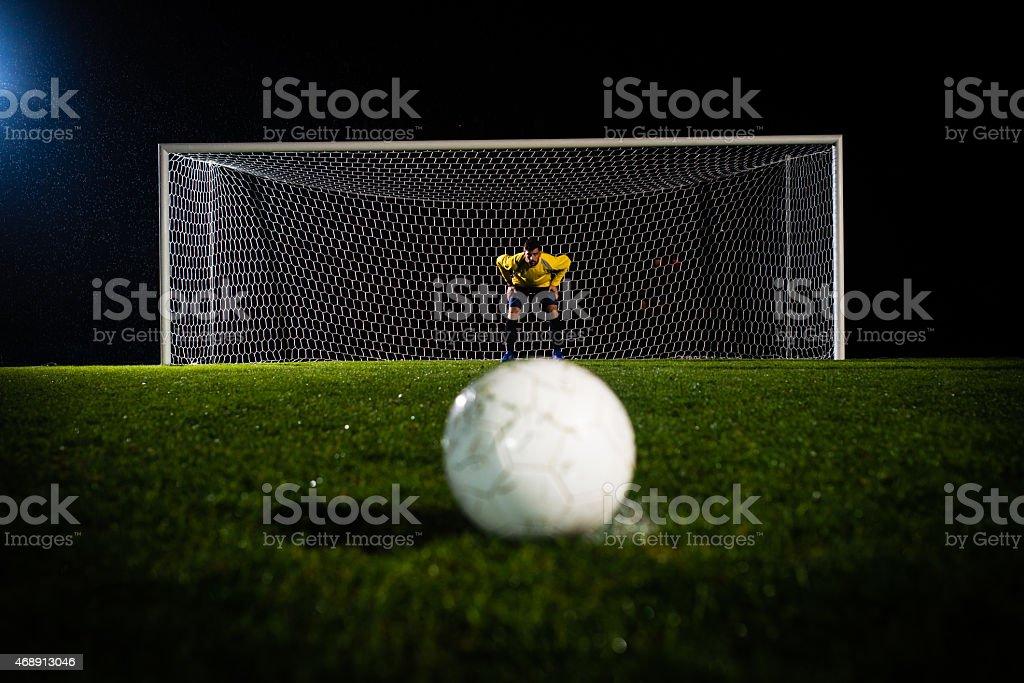 Soccer Ball Against A Goalie stock photo