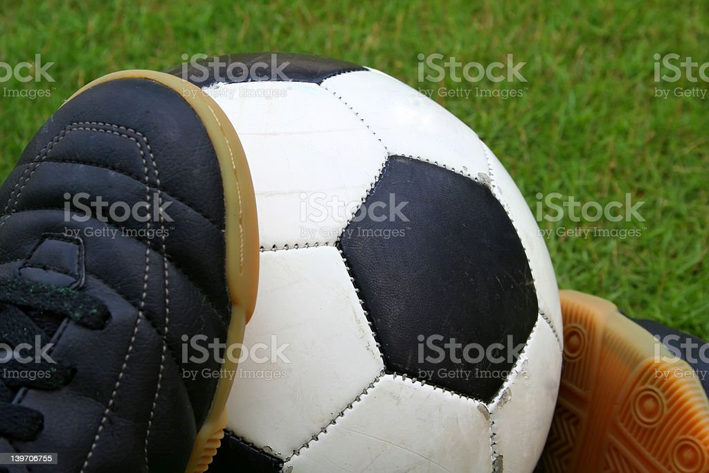 A soccer ball and a pair of shoes royalty-free stock photo
