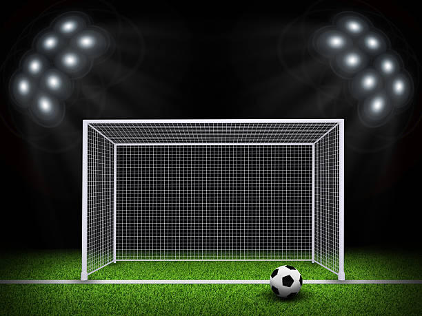Soccer ball and gate in the middle of field stock photo