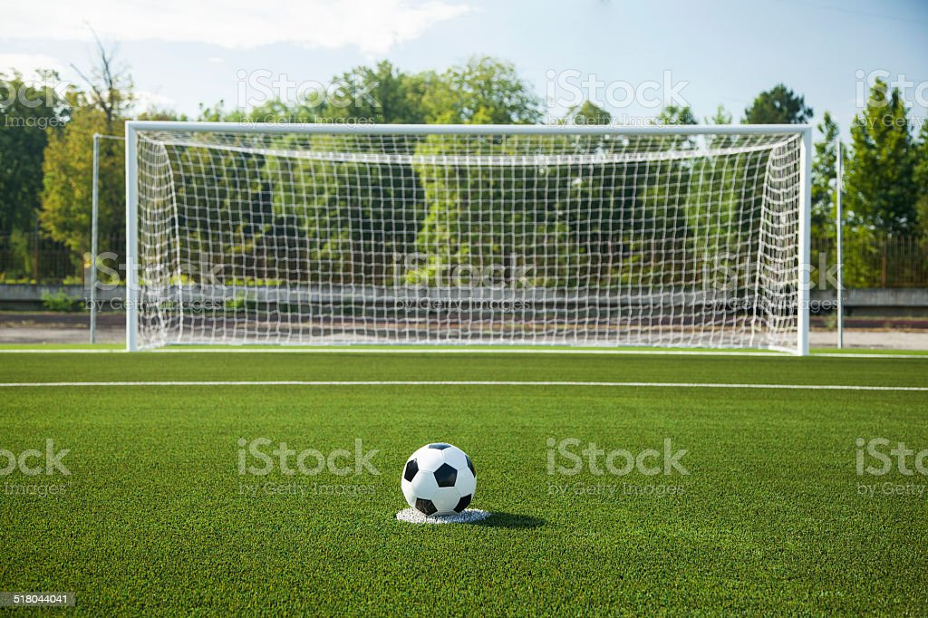 Soccer ball and goal stock photo