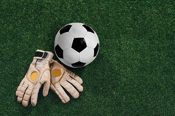 soccer ball and goalkeeper gloves - sports glove stock photos and pictures